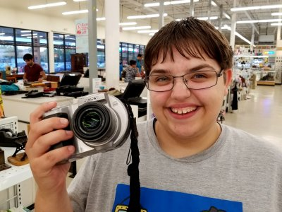 "Elyse holds a ""Big Mavica"" type camera"