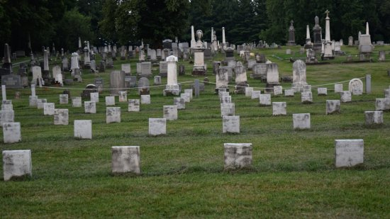 Photo taken from a similar angle as the photo feature from October 2013.  Notice that they added some poles and chains around some of the graves.  I wish that they hadn't done that, because it destroys the scene.