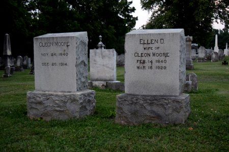 "Headstones for Cleon and Ellen Moore.  Ellen's stone irks me a little, though, because it sort of indicates that her identity is completely tied to her husband, and that she is not an individual in her own right.  It's kind of like people who sign their name ""Mrs. John Doe"" instead of ""Jane Doe""."