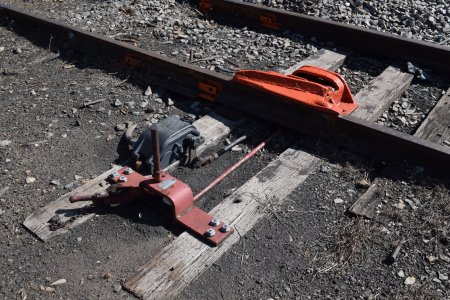 The derailer, set to guide any vehicle that crosses it off of the tracks