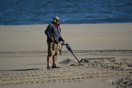 Man using a metal detector.