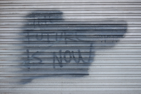 "Painted-out ""The future is now"" graffiti."