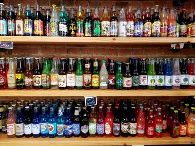 A wall of fruit sodas, ginger beers, and novelty sodas.