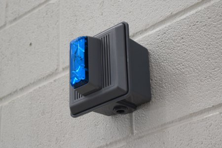 Gray Edwards Integrity horns with blue strobes, used as a simulated fire alarm