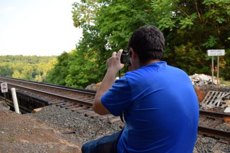 Aaron photographs the railroad bridge.