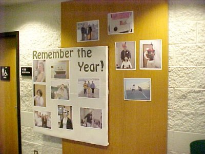 "In April 2002, this was another ""photos"" board.  It was the last bulletin board of the year, and I shared photos that I had taken of various folks in the building over the course of the year."