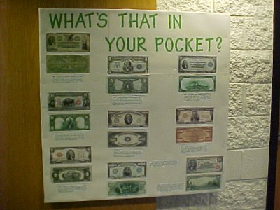 This October 2002 bulletin board was about old money.  It displayed versions of US currency that were no longer issued, as well as larger denominations that were only used for transferring funds between banks.