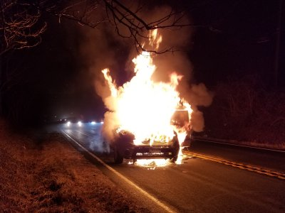 Two minutes later, the car is fully involved, with flames rising twice as high as the car.
