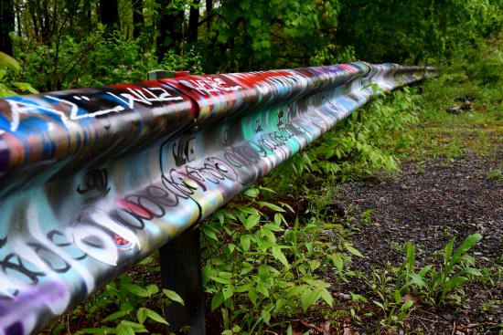 Graffiti-covered guardrail.