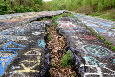 A long and relatively deep fissure in the road caused by ground subsidence.