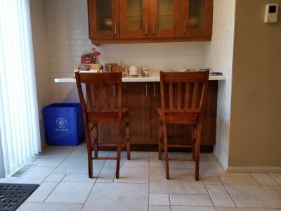 The completed chairs in front of the breakfast bar.