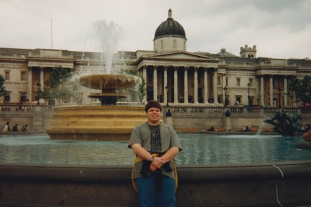 Standing in front of a fountain at Trafalgar Square