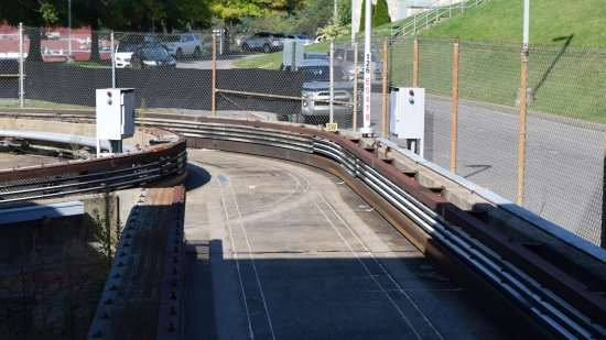 """The roadway on the PRT system, at theHealth Sciences Center station. What looks like a guardrail is actually the """"third rail""""."""