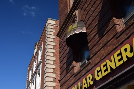 This awning on a window over the Dollar General store demonstrated the vintage quality of downtown. It was clear, with the green growth on it, that this awning had been there for many years.