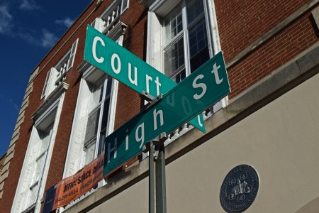 Street sign for Court and High Streets.
