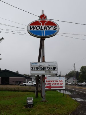 """Wolky's"" on an Amoco sign"