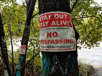 """Stay out, stay alive.  Mines and quarries are not playgrounds.  No trespassing.  Violators will be prosecuted."""