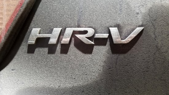 HR-V badging on the back hatch, encrusted with all kinds of dirt.