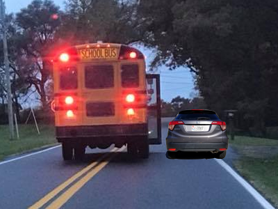 The school bus photo, with my Honda HR-V to scale, showing that there is enough room for a vehicle to pass the school bus on the right