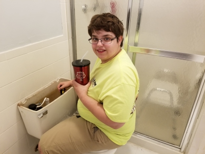 Elyse dismantles her old toilet