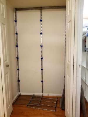 The linen closet, empty, with tape marking where I planned to put the shelves.