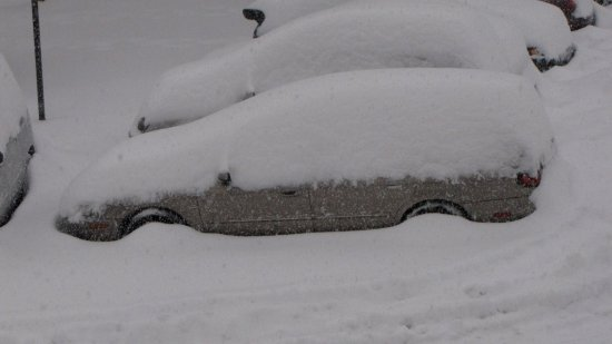 My car at the time, a Mercury Sable, covered with snow.