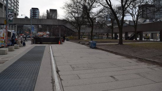 "The sidewalk next to Nathan Phillips Square, which Muffy rode along in search of a new home in ""Our Story Part 1""."