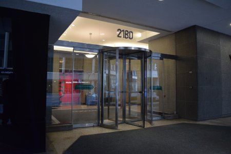 "The entrance to 2180 Yonge Street, used as the main office in ""Our Story Part 2"", where Jodie ran completely around the revolving door, realized what she did, and then ran back in."