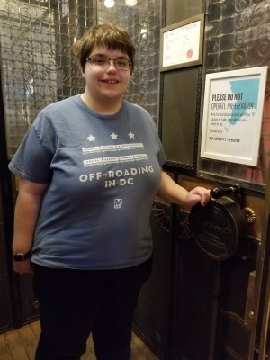 Elyse poses with the controls for the manual elevator at the Gladstone Hotel.