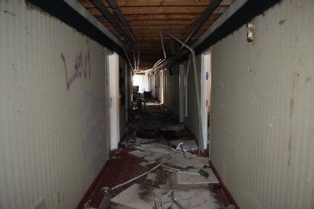 First floor corridor. Note that the drop ceiling is completely gone. Wires were hanging from the ceiling, as well as bits of ceiling grid.