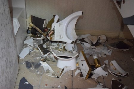 Smashed toilet. None of the toilets in the facility were fully intact, though some were better than others.