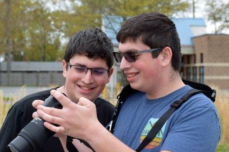 Aaron and Evan look at the shots that Evan took.