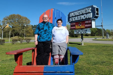 Evan got a photo of Elyse and me standing in the adirondack chair on the line between the two states.