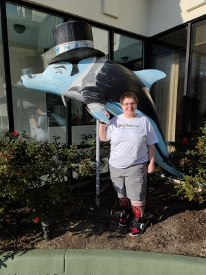 Elyse poses with a dolphin in front of one of the hotels along the strip.
