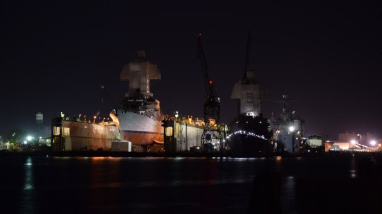 Two ships at Washington Point. The ship to the left, in dry dock, is the USSJason Dunham, an Arleigh Burke-class destroyer. I was not able to determine the identity of the ship to the right.