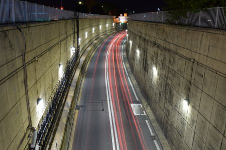 Stacked exposures of the Midtown Tunnel portal, showing taillight streaks.
