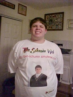 A photo that my sister took of me in June 2000, showing off a freshly made Schumin Web shirt