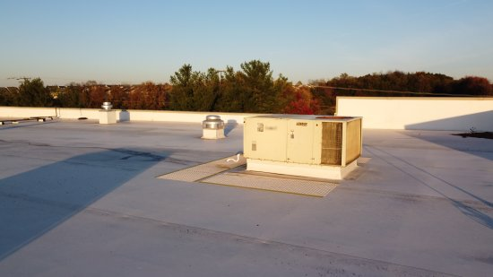 Air handling unit on the roof, approximately over the service desk.