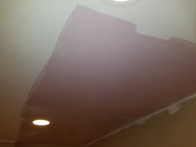 The pink paint on the ceiling of the living room