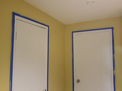 The basement hallway, painted
