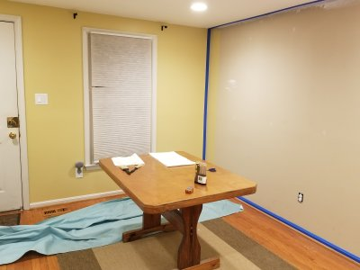 Painting the last of the yellow in the living room.  The side wall is taped in preparation for painting the accent color.
