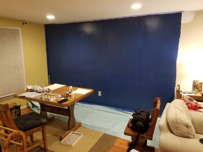 The first session is complete, painting the living room wall blue