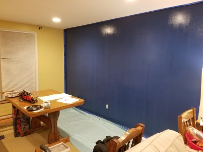 The second coat is applied to the accent wall
