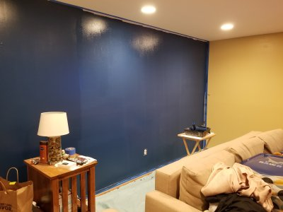 The first coat on the rest of the accent wall is complete.