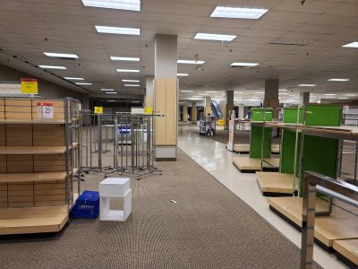 The closed-off section of the lower level of the store, being used to store spare fixtures.