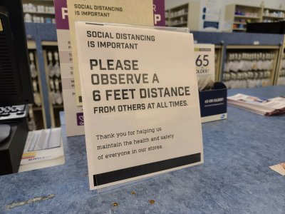 Sign at the pharmacy at Giant Food asking people to be socially distant.