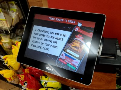 Sheetz started promoting their mobile app on their touchscreens.  I still used the touchscreen, though.  I imagine that the touchscreens are cleaned more often than most people's phones, too.