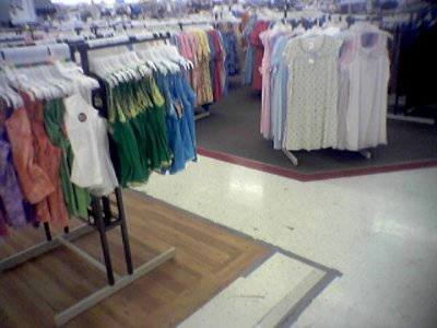 In the clothing areas, the carpeting was replaced by wood-look tile.  Interestingly enough, I learned from working at Walmart back then that the color of the carpet was chosen because it was the same color as most stains.  The wood look is definitely an improvement.