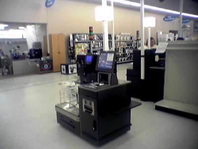 The new front end replaced the old color scheme with blue registers and red numbers with black, and introduced self checkout machines for the first time.  The self checkouts were IBM models.