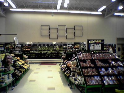 New black wall and aisle signage going up in the grocery section.